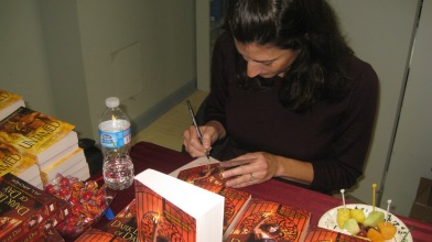 Jill Archer signing copies of Dark Light of Day
