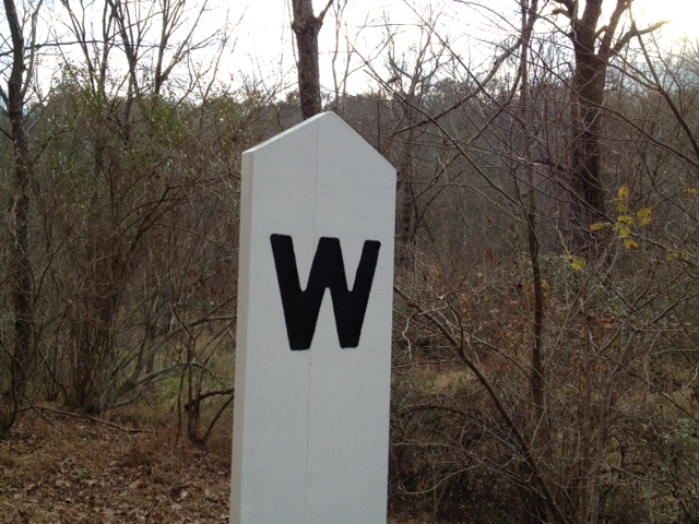 """W"" is for WHITE HEART OF JUSTICE (Couldn't resist. ""W"" is actually for ""Whistle."" These posts told train conductors that there was an intersection ahead and it was time to warn drivers that a train was coming.)"