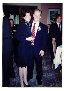 """Our engagement party circa 1995. I'm rocking the """"young lawyer"""" look, huh? And some seriously curly hair!"""