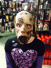 Younger daughter at Halloween store